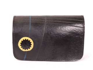 Passport cover 4 in L x 5.6 in W made of recycled tire products. 2 tabs for passport and other document.