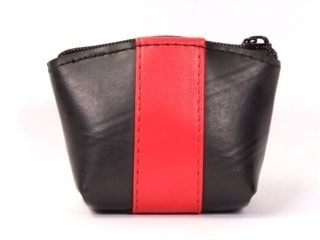 Cora wallet 4 in L x 3.5 in H x 1.5 in D, made of recycled tire products and colored faux leather, zipper closure.