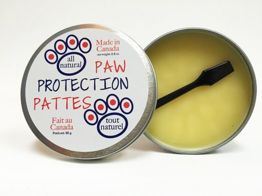 All natural paw protection balm for pets, made in Canada. Open 80 g tin with applicator.