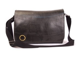 Handbag made of recycled tire inner tube. Cotton lining and adjustable strap. Front flap, zippered top.