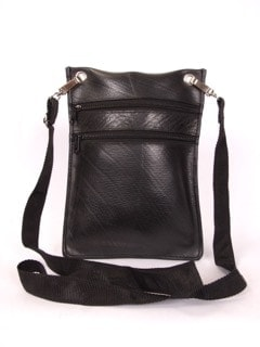 """Passport bag made of recycled tire products. Fine cotton interior lining. Two zippered pockets and 13"""" adjustable strap."""