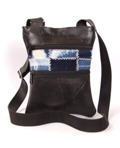 Recycled tire bag with fabric accents dyed with natural indigo. Two zipped exterior pockets and two interior zipped pockets.