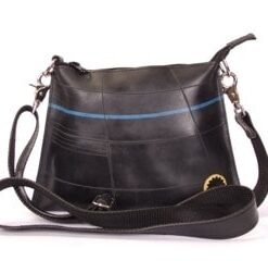 Original tube bag made of recycled tyre products. Cotton canvas lining, cell pocket, nickel hardware. Adjustable strap.